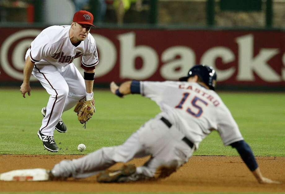 Jason Castro reaches second and the Astros score their second run in the first inning Monday, thanks to an error by D-Backs second baseman Aaron Hill. Photo: Ross D. Franklin, STF / AP