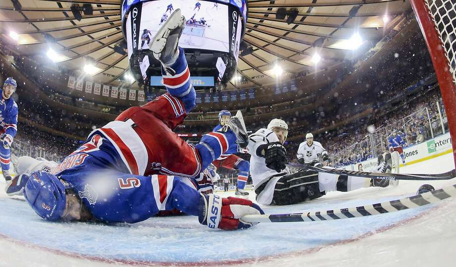 New York defenseman Dan Girardi (5) tries to clear the puck from the goal line as the Kings' Marian Gaborik tries to score. Photo: Bruce Bennett, Associated Press