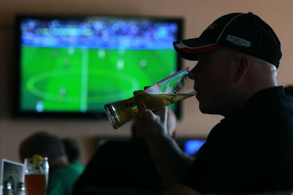 Scott Benner watches the UEFA Champions League final match at Speisekammer restaurant and bar in Alameda, Calif. on Saturday, May 24, 2014. The World Cup soccer tournament begins June 12 in Brazil.