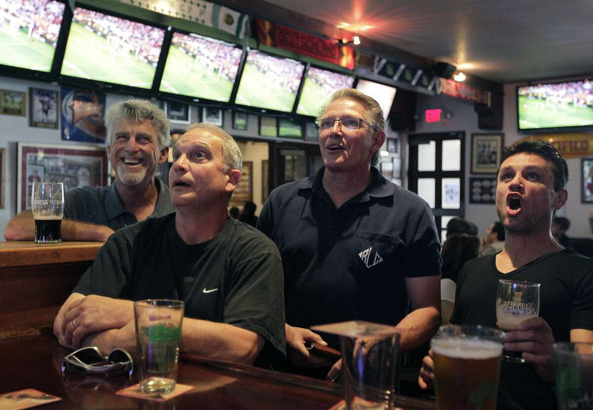 Fans watch last month's UEFA Champions League final at the Englander in San Leandro. Owner Roy Childress says,
