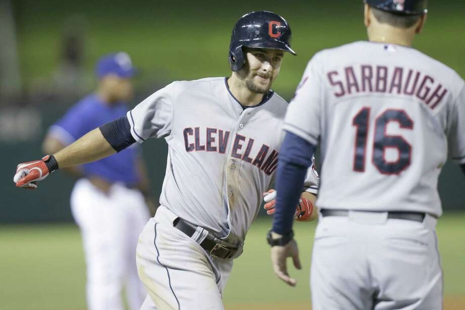 The Indians' Lonnie Chisenhall (left) hit three homers and had nine RBIs against the Rangers. Photo: L.M. Otero / Associated Press / AP