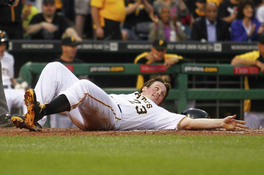 The Pirates' Travis Snider scores on an RBI double in the fifth inning against the Cubs. Photo: Justin K. Aller / Getty Images / 2014 Getty Images