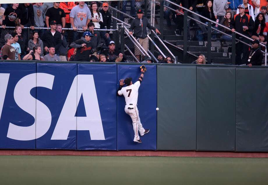 Gregor Blanco can't catch up to Ian Desmond's triple in the second inning. Photo: Kevin N. Hume, The Chronicle