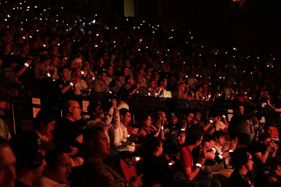 The crowd lights up with complimentary wrist bands from Ubisoft during the Ubisoft media briefing  at the E3 video game conference held at the Orpheum Theater June 9, 2014 in Los Angeles, California.. The annual video game conference and show runs June 10-12.  Photo: Dan R. Krauss, Getty Images