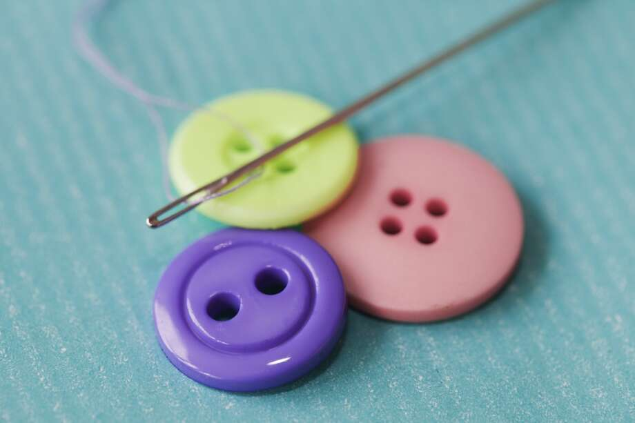 How to sew on a button (extra credit if you can sew Halloween costumes). Photo: Johner Images, Getty Images/Johner RF