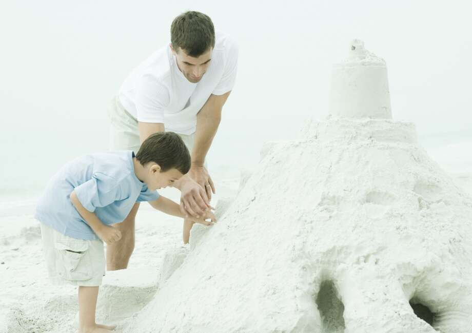 How to build a sand castle. Photo: Frederic Cirou, Getty Images/PhotoAlto