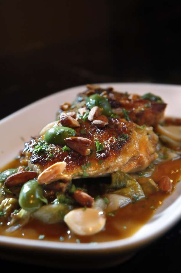 Barbacco: Chicken thighs with olives and garlic. Photo: Carlos Avila Gonzalez, The Chronicle