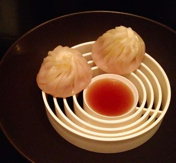 Benu: Xiao long bao, which used to be filled with foie gras, is now filled with lobster coral. There's always a gush of hot liquid and an explosion of flavor as you bite through the bun and strike the treasure within.