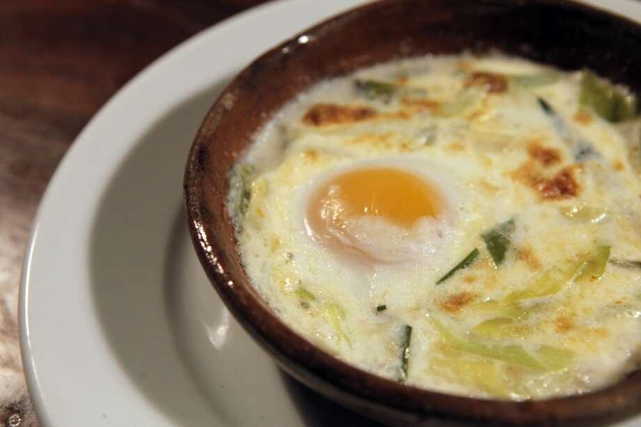 Camino, Oakland: Wood oven-baked egg with herbs and cream. Photo: Carlos Avila Gonzalez, The Chronicle