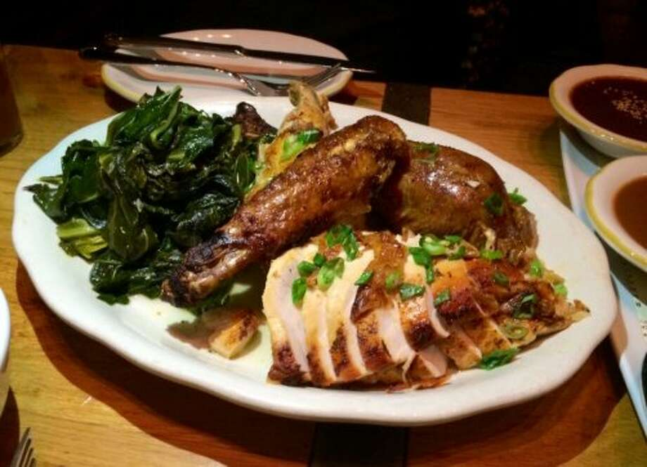 Comal, Berkeley: Roast rotisserie turkey served with  three moles, collard greens, black beans, rice and warm tortillas.