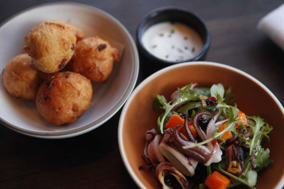 Frances: Applewood smoked bacon beignets with creme fraiche and chives (rear). Photo: Mike Kepka, The Chronicle