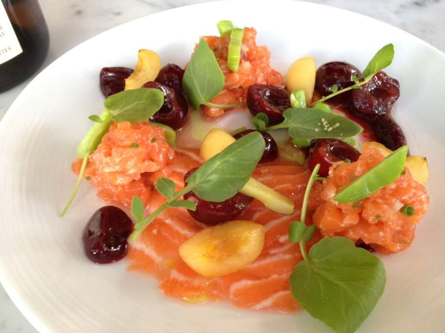 Local's Corner: Sliced salmon and salmon tartare with cherries and apricots. The restaurant has a kitchen without burners so much of the fish on the daily changing menu is raw.