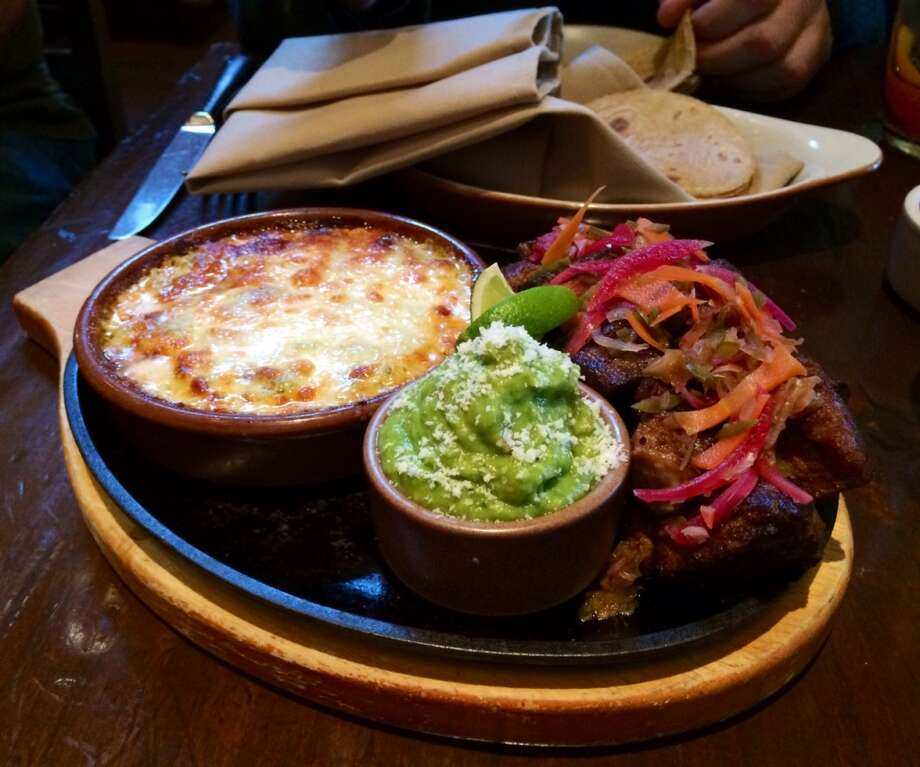 Mamacita: Carnitas with seven-layer cheese dip and guacamole.