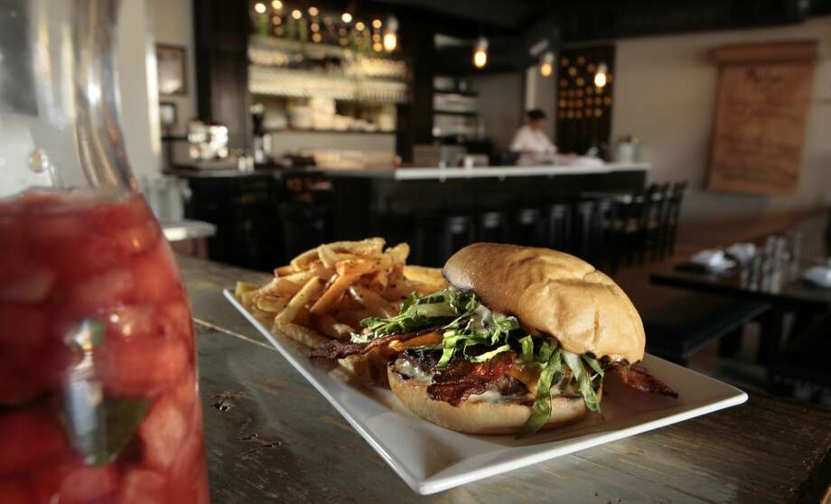 Marlowe:  Hamburger (with the secret ingredient of lamb)   with a slather of horseradish aioli, crisp bacon, cheddar cheese, caramelized onions,  cold shredded lettuce.  The fries are some of the best around, Photo: John Storey, Special To The Chronicle