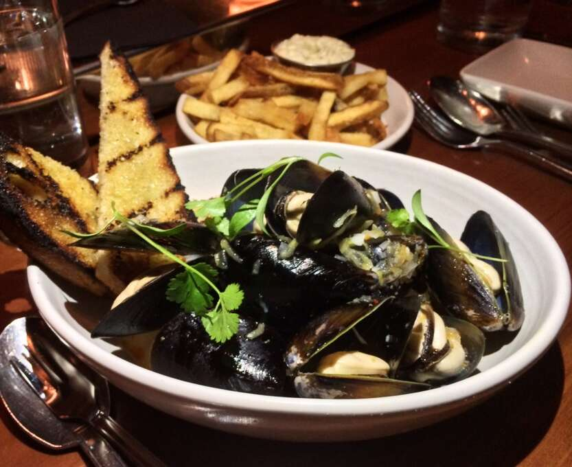 Maven: Penn Cove mussels with chiles, absinthe and grilled bread, with French fries in the background.