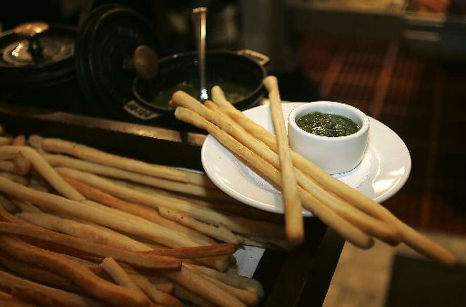 Perbacco: Each meal begins with house made breadsticks that are crispy and buttery.