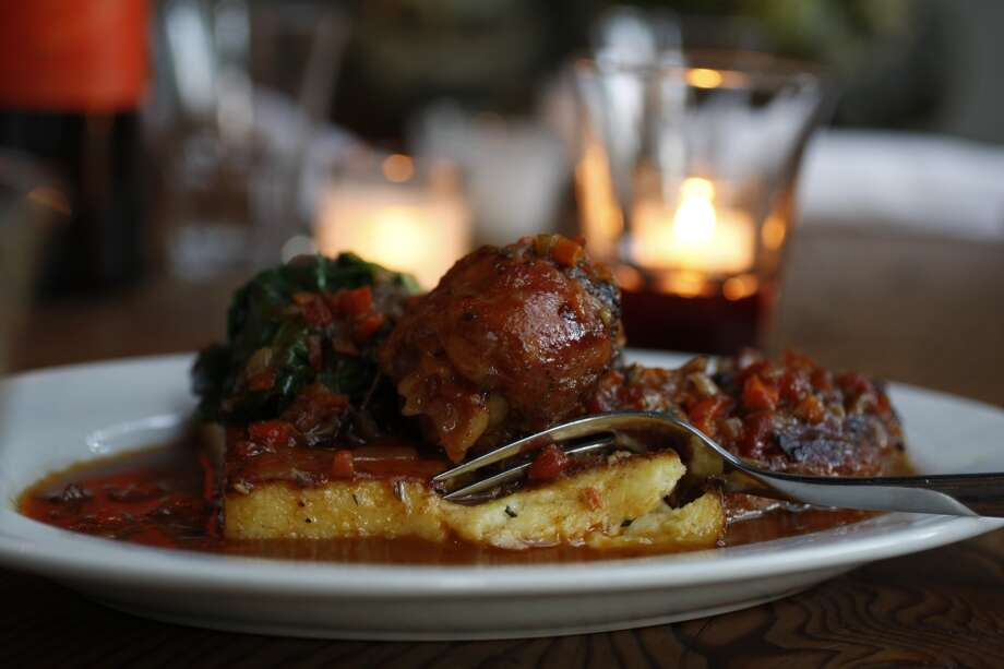 Scopa, Healdsburg: Nonna's tomato-braised chicken  with sauteed greens  and toasted polenta. Photo: Eric Luse, The Chronicle