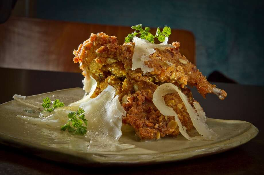 State Bird Provisions: Fried quail on a bed of stewed onions. Photo: John Storey, Special To The Chronicle