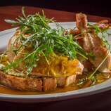 Tosca Cafe: Whole roast chicken served family-style on a thick slice of toast that's been dipped in the juices and spread with a ricotta-pine nut stuffing. The subtle caramel flavor of Marsala sauce enhances the crisp skin and succulent flesh.
