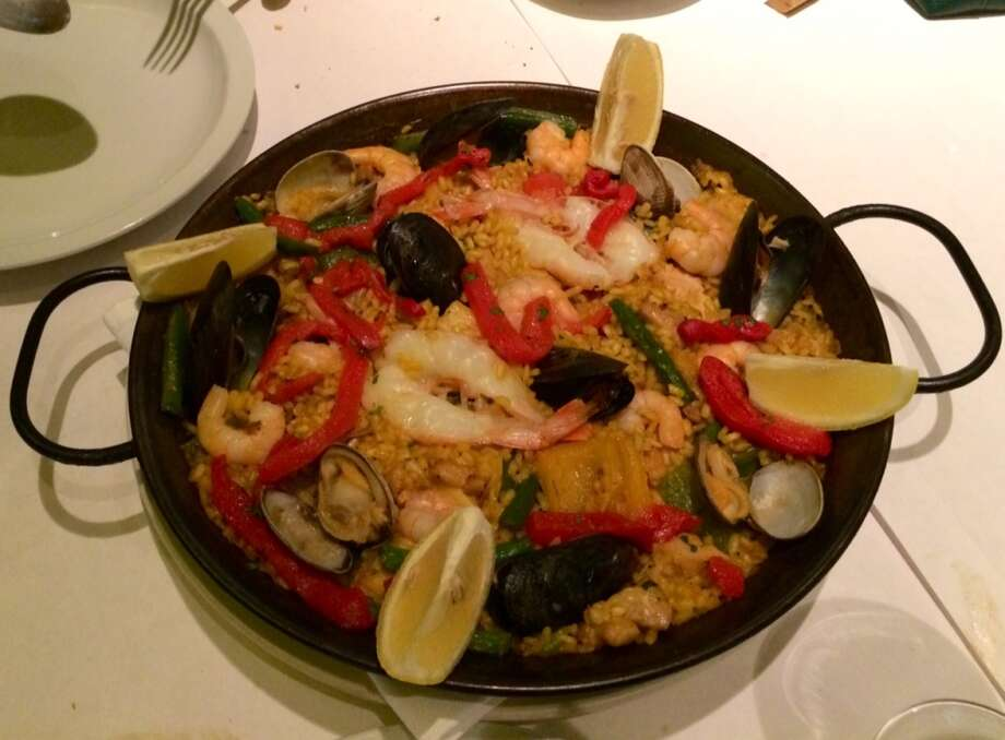 Zarzuela: Paella with seafood, chicken and vegetables.