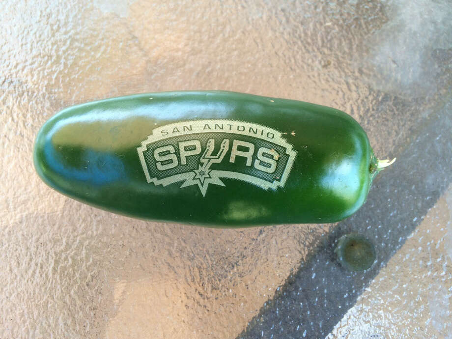 A jalapeno laser engraved with the San Antonio Spurs logo by Christian Silva and his father Humberto Silva. Photo: Courtesy,  Christian Silva