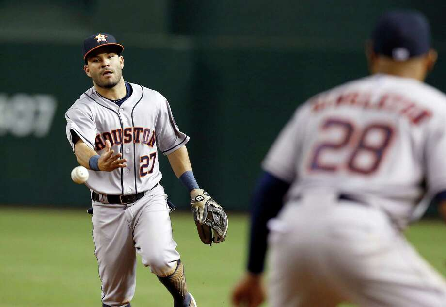 Houston Astros' Jose Altuve (27) flips the ball to Jon Singleton (28) to get Arizona Diamondbacks' Ender Inciarte out at first base during the third inning of a baseball game on Monday, June 9, 2014, in Phoenix. (AP Photo/Ross D. Franklin) Photo: Ross D. Franklin, Associated Press / AP