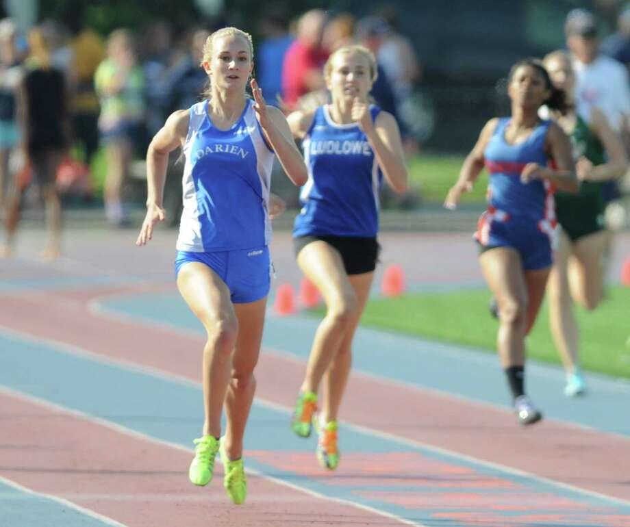 Darien's Anna Sulger leads the pack down the home stretch in the girls 100 meter dash at the FCIAC track and field championships at Danbury High School on Tuesday, May 27. Photo: Tyler Sizemore / The News-Times