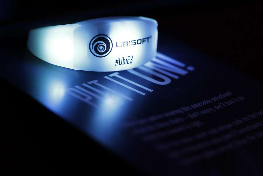 Light-up wrist bands by Ubisoft were given to attendees during a media briefing at the E3 video gaming conference at the Orpheum Theater June 9, 2014 in Los Angeles, California. The annual video game conference and show runs June 10-12.  Photo: Dan R. Krauss, Getty Images