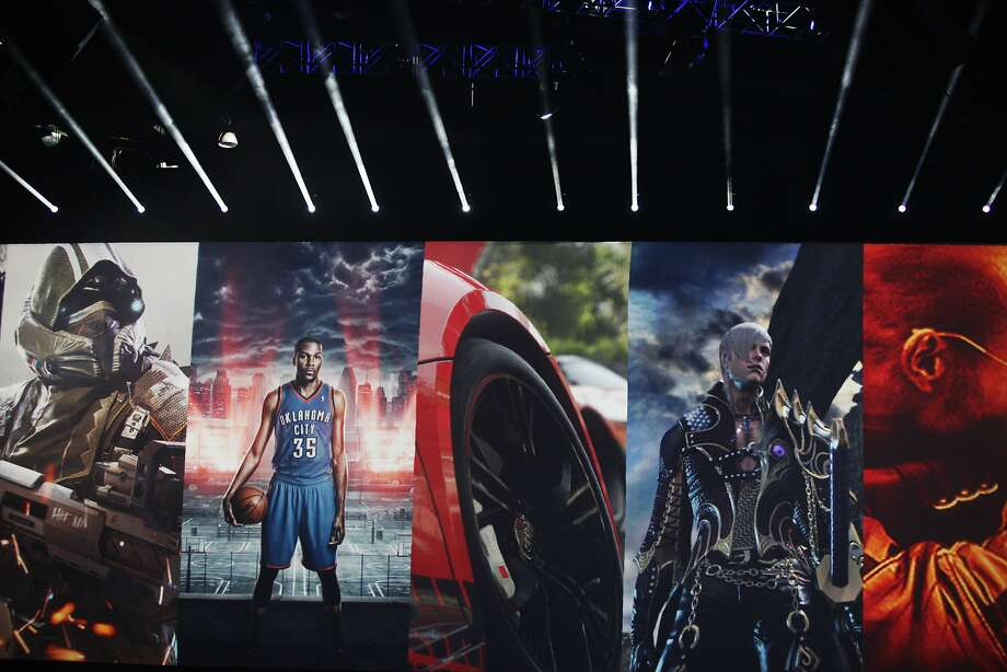 A collage of PS4 games are displayed during the Sony press conference at E3 June 9, 2014 in Los Angeles, California. The annual video game conference and show runs from June 10-12.  Photo: Dan R. Krauss, Getty Images