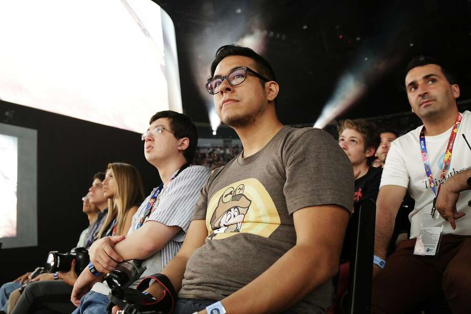 Members of the audience listen during the Sony press conference at E3 June 9, 2014 in Los Angeles, California. The annual video game conference and show runs from June 10-12. Photo: Dan R. Krauss, Getty Images