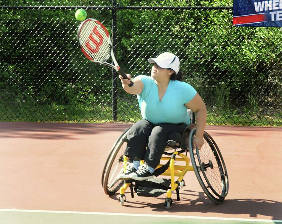 Bene Wilsted, of The Woodlands, hits her forehand during a tennis practice. Stelios Vafiadis, of The Woodlands,teaches tennis to wheelchair bound men and women. Photo by David Hopper Photo: David Hopper, Freelance / freelance