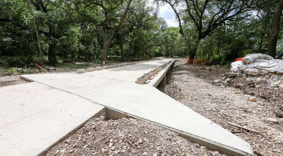 A portion of the Salado Creek hike and bike trail is under construction across the street from Last Chance Forever on  May 29. The center fears the project will boost flooding. / Express-News 2014