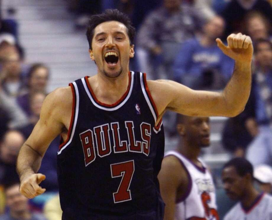 "10. Toni Kukoc, Croatia — A 6-foot-11 forward with the outside shooting ability of a guard, ""Euro Magic"" was a member of three championship teams with the Bulls and won the NBA's Sixth Man of the Year in 1996. Photo: KEVIN FRAYER, Associated Press"