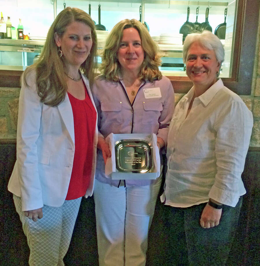 The New Canaan Chamber of Commerce recently presented its annual awards. Volunteers of the Year were, from left, Elizabeth McCarthy, of Aetheria Relaxation Spa, left, and Shirleen Dubuque, of Village Critter Outfitter, right. With them, chamber board member Lisa Corrado of Lisa Corrado Nutrition. Photo: Contributed Photo, Contributed / New Canaan News Contributed