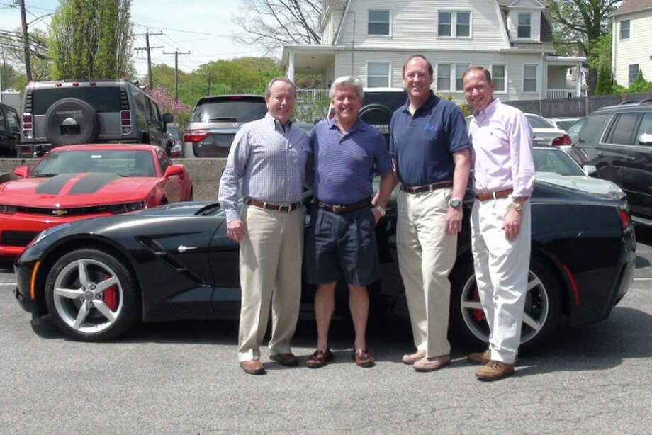 Getting ready to give away a 2014 Corvette Stingray are, from left, Leo Karl III, president of Karl Chevrolet, of New Canaan; Mark Curtis, co-owner of Splash Car Wash; Chris Fisher, co-owner of Splash Car Wash; and Steve Karl, vice president of sales for Karl Chevrolet. Photo: Contributed Photo, Contributed / New Canaan News Contributed