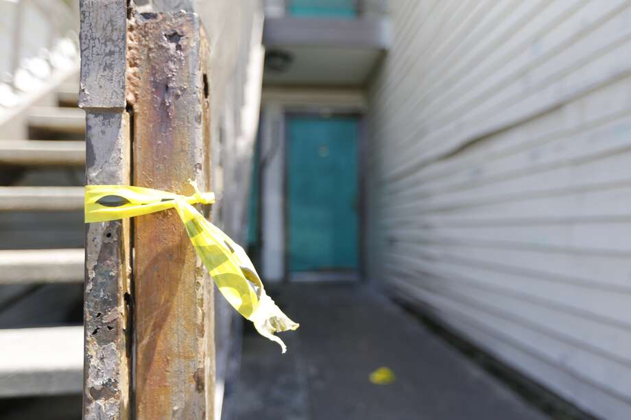 A girl, believed to be about 9 years old, was found dead and wrapped in blankets Monday evening at her family's apartment.  Photo: Johnny Hanson, Houston Chronicle