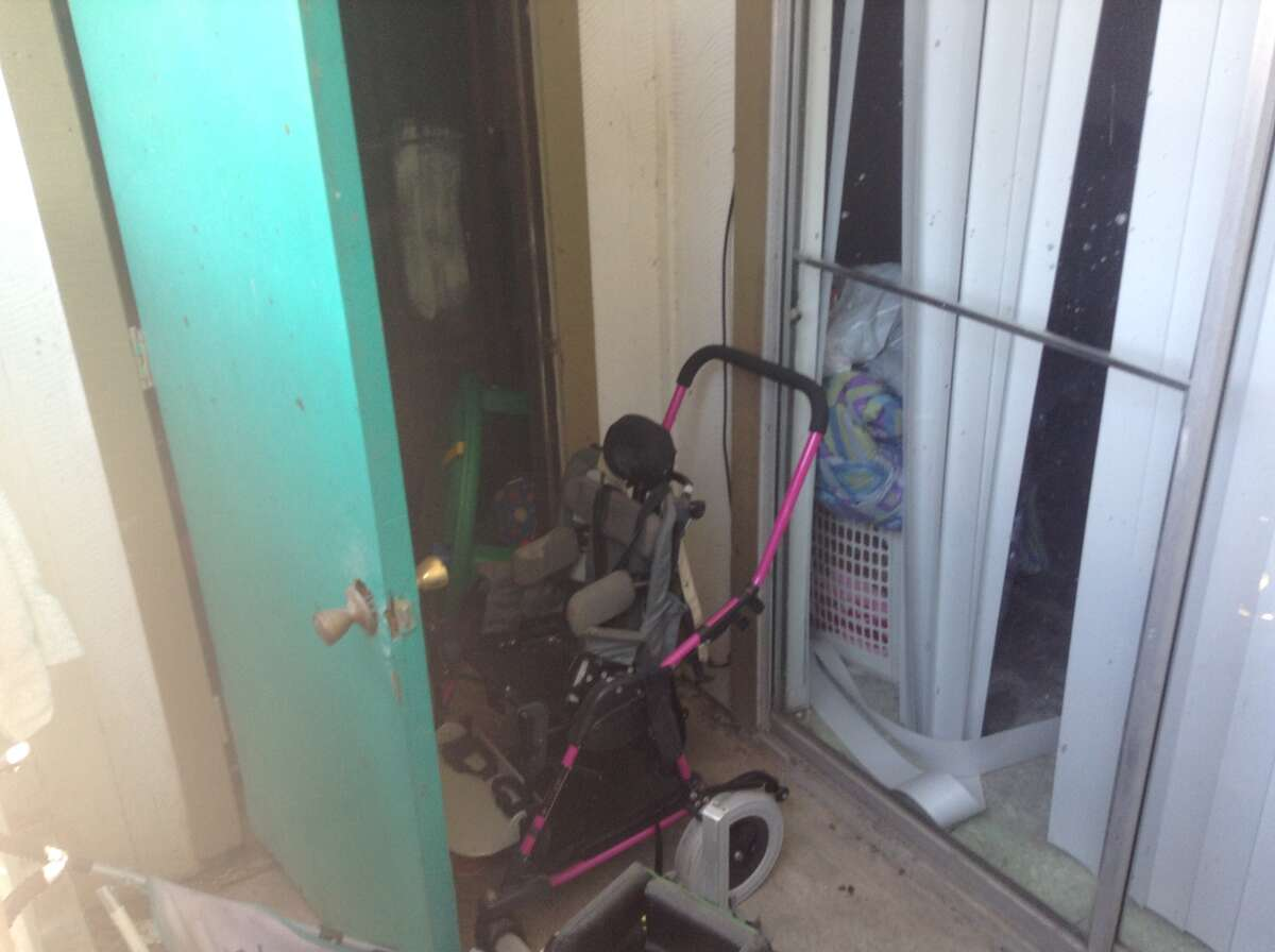 A wheel chair is shown at an apartment where where a girl, believed to be about 9 years old, was found dead and wrapped in blankets Monday evening.