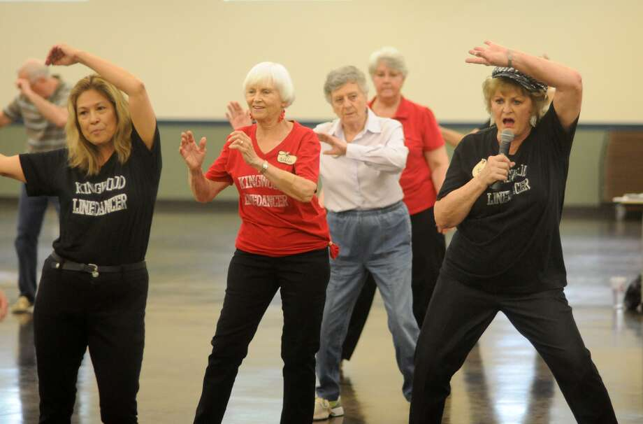 Kay Caffey, right, leads her senior line dancing class at the Kingwood Community Center. Photo: Jerry Baker, Freelance