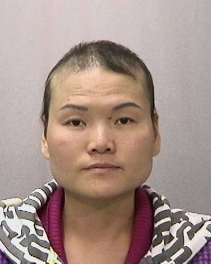 Gaineng He, 36, was arrested Monday, June 9, 2014, with her sister, Qiao, for allegedly running two brothels and an illegal sex trafficking ring out of San Francisco's Richmond District. Photo: Courtesy, San Francisco Police