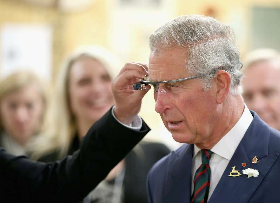Prince Charles tries out Google Glass, a gadget that has drawn a lot of attention, during a visit to Canada last month. Photo: Chris Jackson, Getty Images