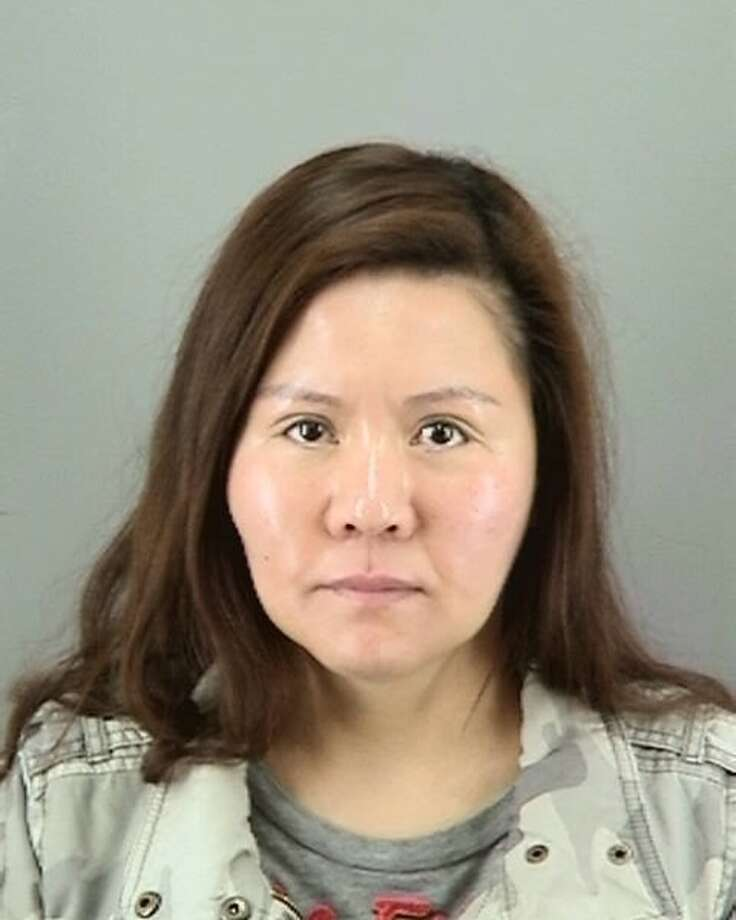 Qiao He, 37, was arrested Monday, June 9, 2014, with her sister, Gaineng, for allegedly running two brothels and an illegal sex trafficking ring out of San Francisco's Richmond District. Photo: Courtesy, Courtesy SFPD / ONLINE_YES