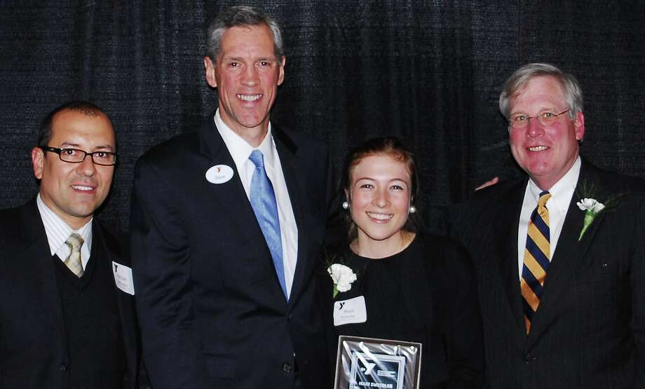 Madi Sweedler is presented with the Youth Volunteer of the Year award from the YMCA. From left: Hernan Bohorquez, Alpha Community Services YMCA senior director of transitional living; David Stevenson, Central Connecticut Coast YMCA president; Sweedler; and Jon Leckerling, past board chairman of the Central Connecticut Coast YMCA. Photo: Contributed Photo / Westport News