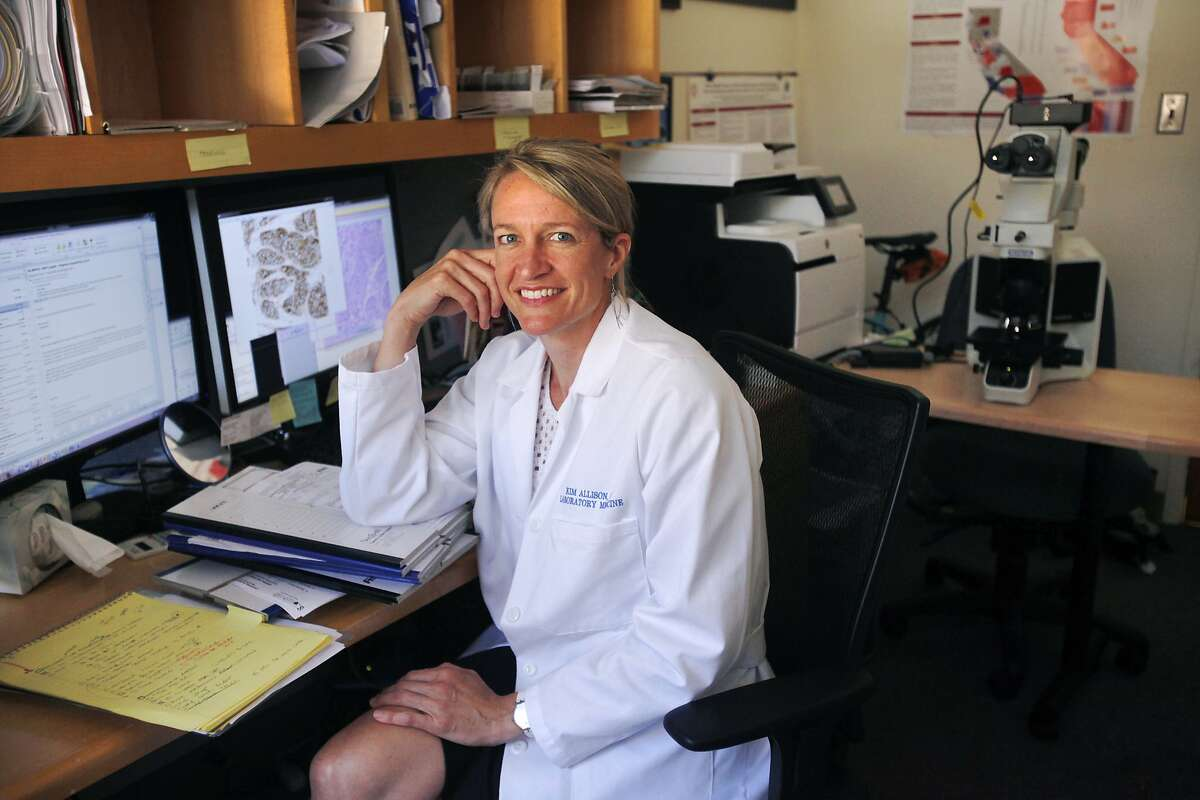 Dr. Kimberly Allison, 39, pictured in her office where she works as a pathologist, specializing in breast cancer, June 6, 2014 at the Stanford School of Medicine in Stanford, Calif. At age 33, Allison was diagnosed with breast cancer. She said that the experience, though very