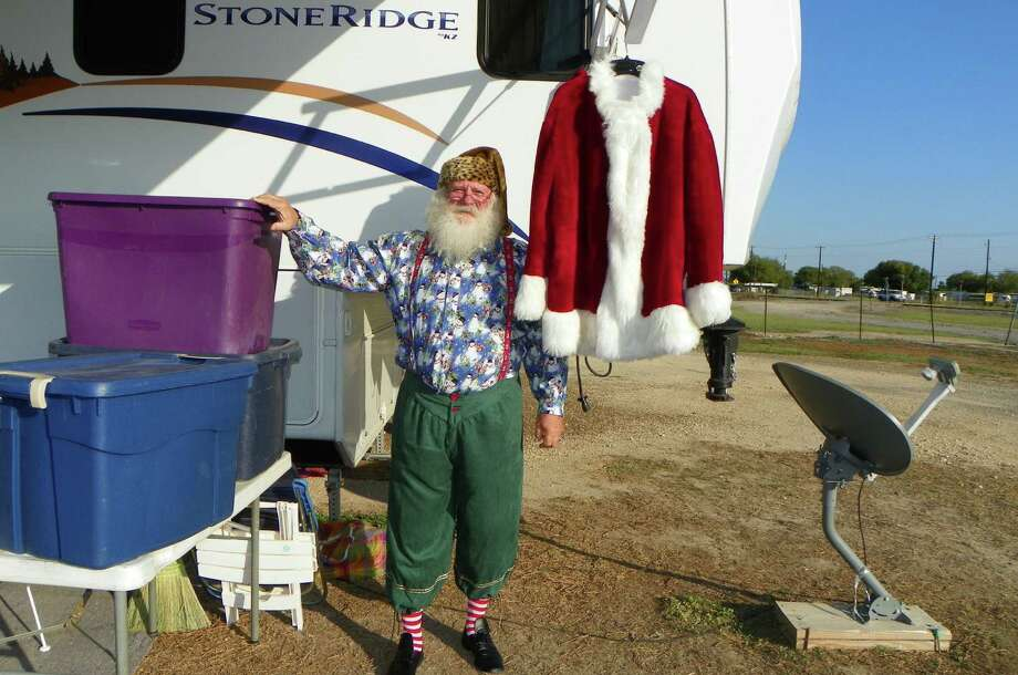 Santa Claus models a new outfit Mrs. Claus recently made for him. After Christmas he says he takes a long nap. Photo: Courtesy