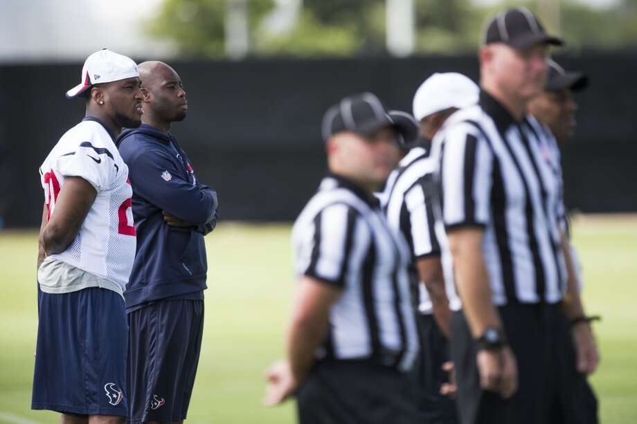 Texans safety Chris Clemons, left, and cornerback Johnathan Joseph watch practice. Photo: Brett Coomer, Houston Chronicle