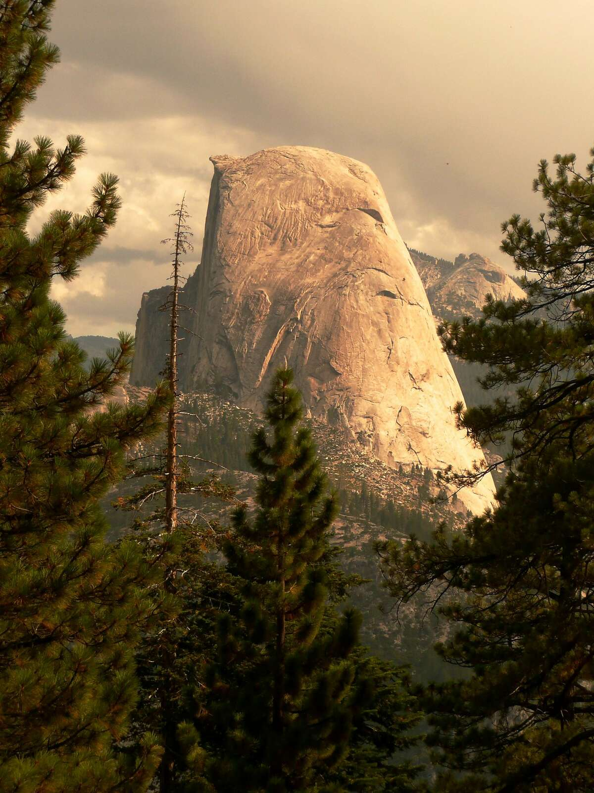 Unusual view of Half Dome on the hike from Glacier point to Happy Isles.