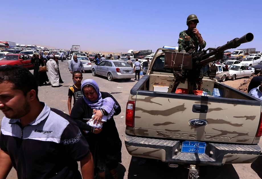 Iraqi families flee violence in northern Nineveh province after suspected jihadists seized the province and much of the capital city, Mosul. Photo: Safin Hamed, AFP/Getty Images