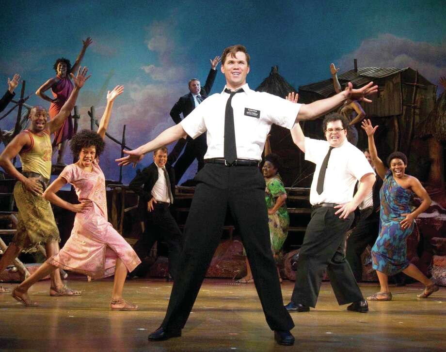 "In this theater publicity image released by Boneau/Bryan-Brown, Andrew Rannells, center, performs with an ensemble cast in ""The Book of Mormon"" at the Eugene O'Neill Theatre in New York. The Broadway musical is nominated for 14 Tony Award nominations.  The Tony Awards will be broadcast live on Sunday, June 12, 2011. (AP Photo/Boneau/Bryan-Brown, Joan Marcus) Photo: Joan Marcus / AP2011"