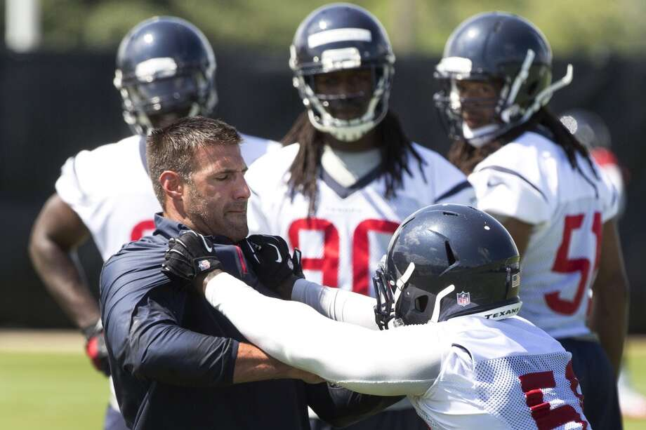 Texans linebackers coach Mike Vrabel, left, works with linebacker Whitney Mercilus. Photo: Brett Coomer, Houston Chronicle