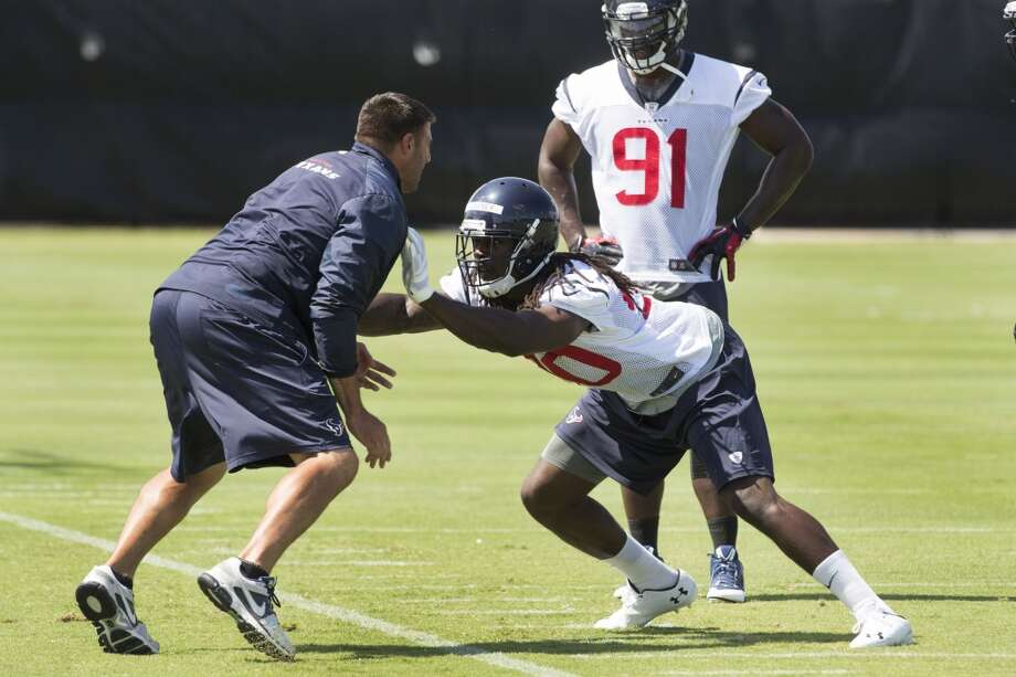 Texans linebackers coach Mike Vrabel, left, works with Jadeveon Clowney (90) as Ricky Sapp (91) looks on. Photo: Brett Coomer, Houston Chronicle